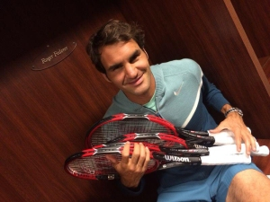 Roger Federer with an armful of tennis racquets made with extruded aluminum. Nobody, not even the recreational player, uses a wooden tennis racquet today. So why are artists still using wooden stretcher bars for their paintings?